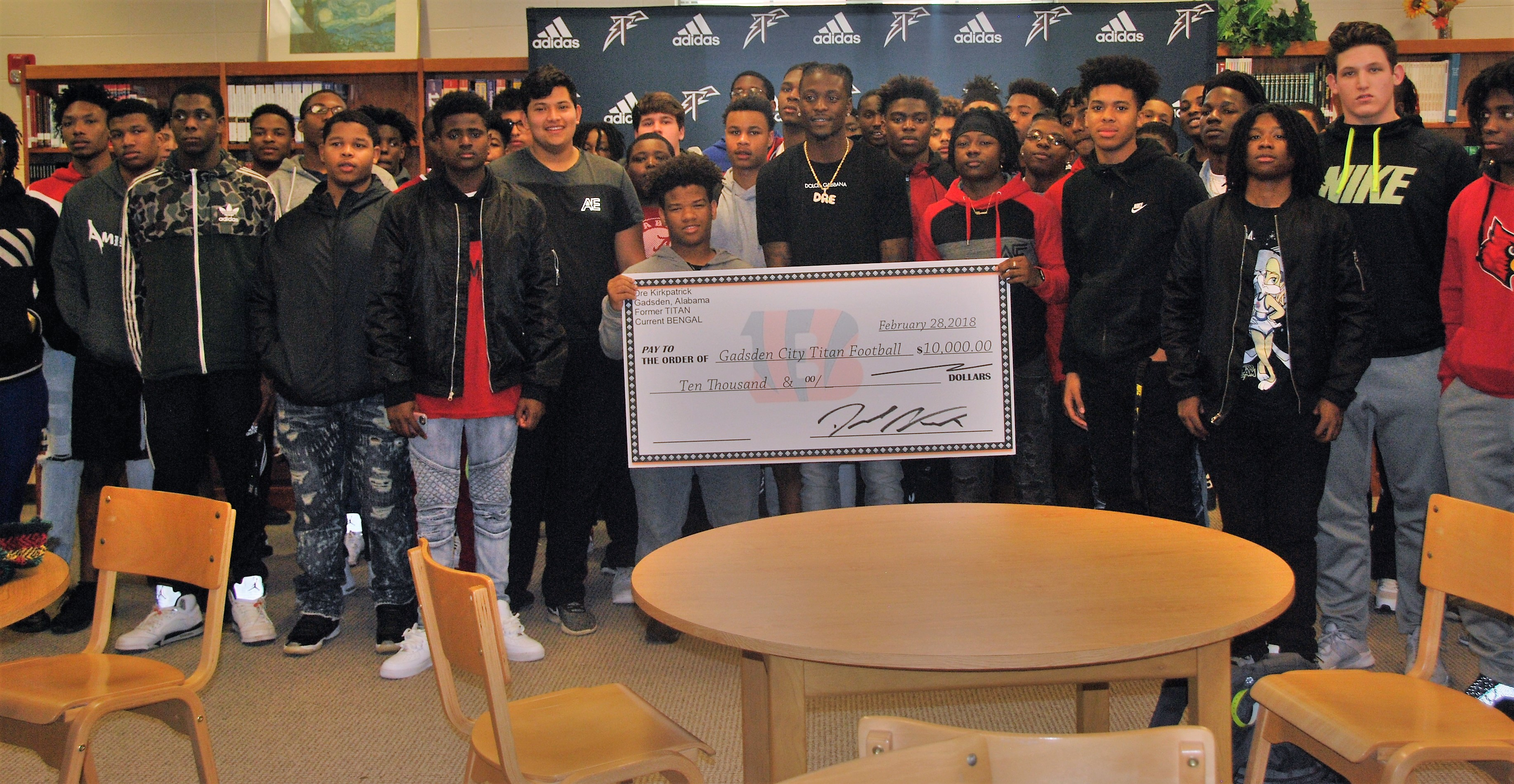 Dre with Members of the GCHS Football Team