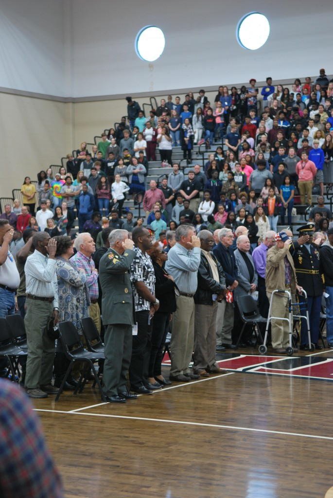 Veterans saluted the U.S.A. flag.